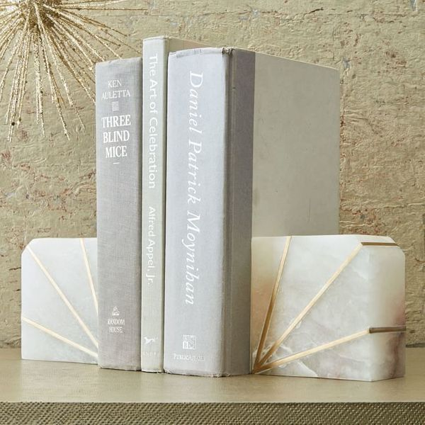 "<i>Buy them from <a href=""https://www.westelm.com/products/stone-bookend-alabaster-d4203/"" target=""_blank"">West Elm</a> for $"