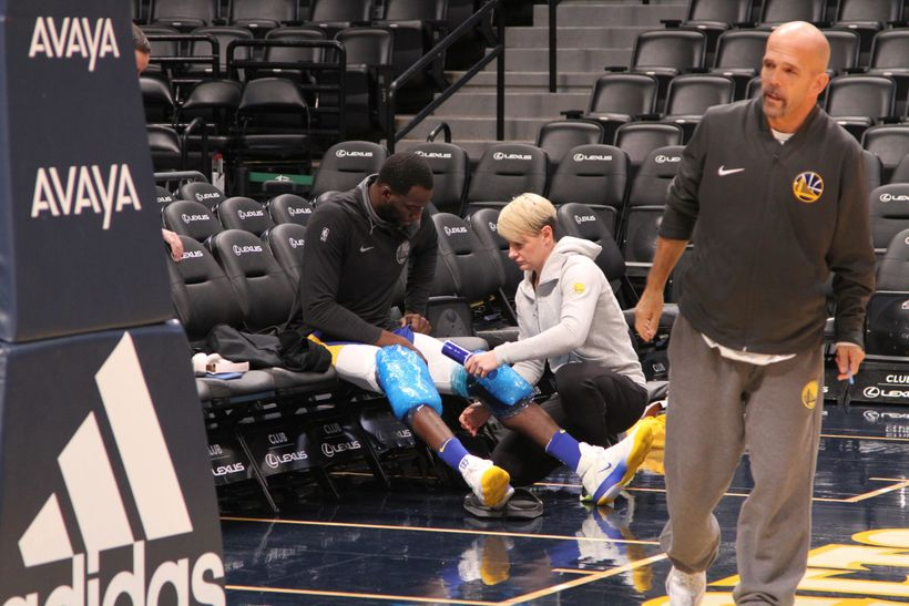 Reigning Defensive Player of the Year Draymond Green has his knees wrapped with ice following the Warriors' morning shoot aro