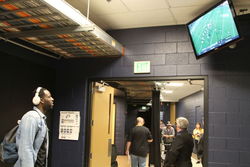 Draymond Green watches his alma mater Michigan State University win in the closing minutes prior to getting dressed for the g