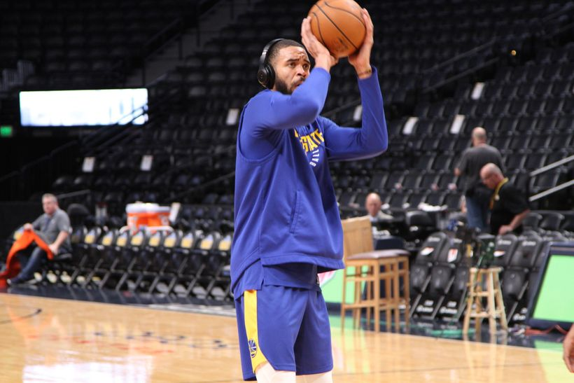 JaVale McGee practices free throws during the Warriors' pregame warmups.