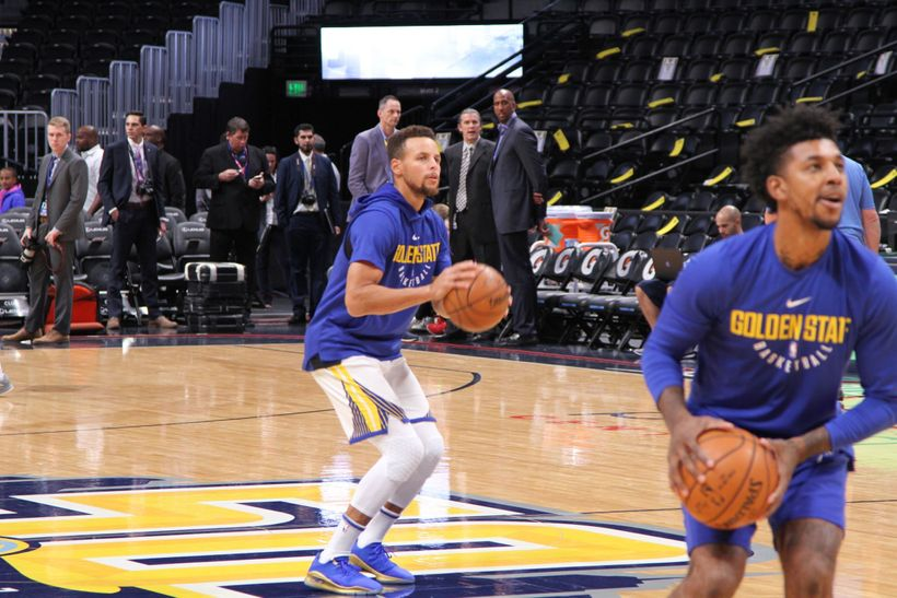 Stephen Curry gets ready to launch a half court shot during pregame warmups.  Newly acquired Golden State Warriors guard Nick