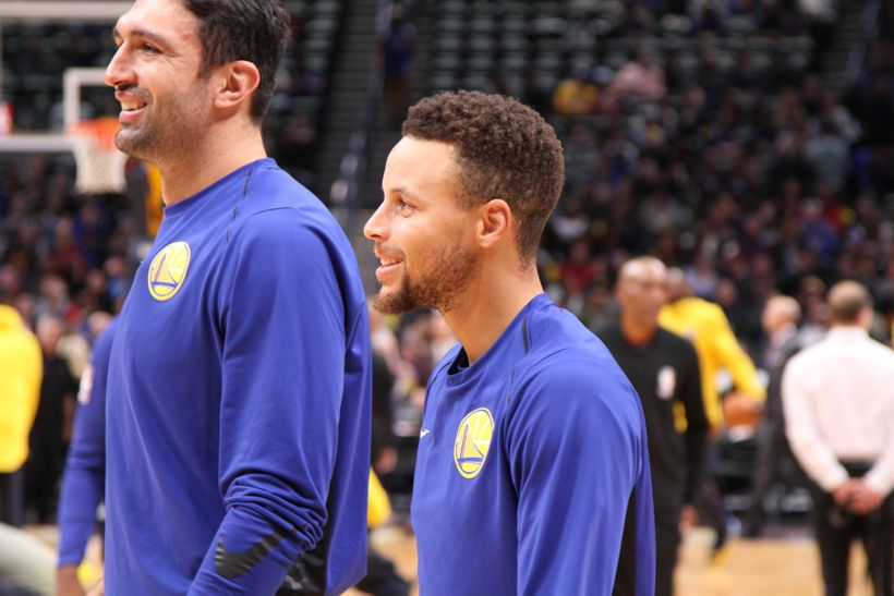 Stephen Curry and Golden State Warriors starting center Zaza Pachulia during pregame warmups.