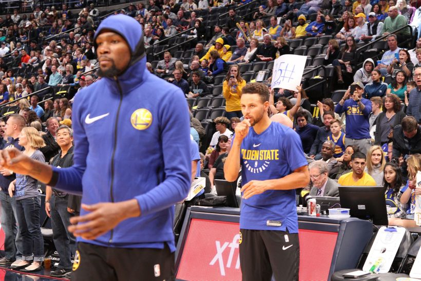 Golden State Warriors superstars Kevin Durant and Stephen Curry during pregame warmups.