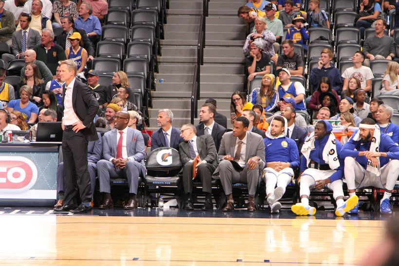 The Warriors bench near the conclusion of their 127-108 victory.