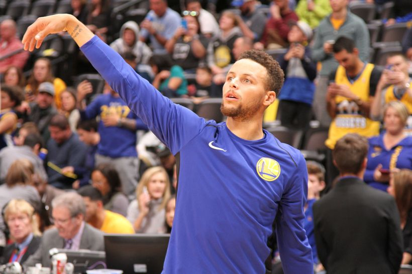 Golden State Warriors point guard Stephen Curry with the perfect form during pregame warmups.