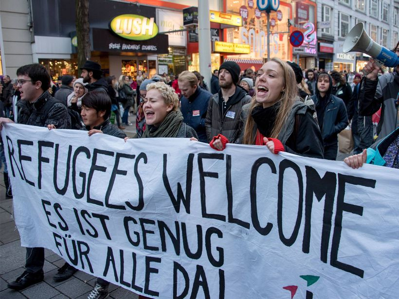 Protestors in Austria showing their support for refugees.