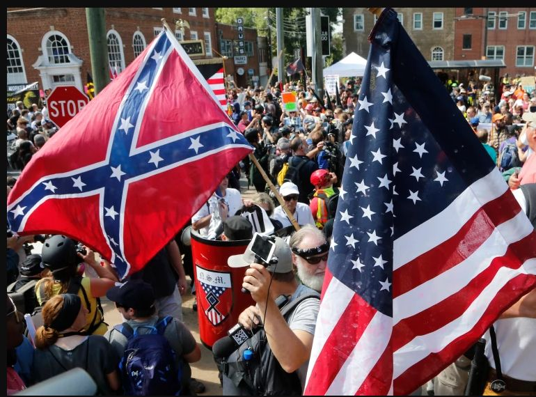 Alt-Right marches in Charlottesville carried Confederate and U.S. flags and Nazi paraphernalia.