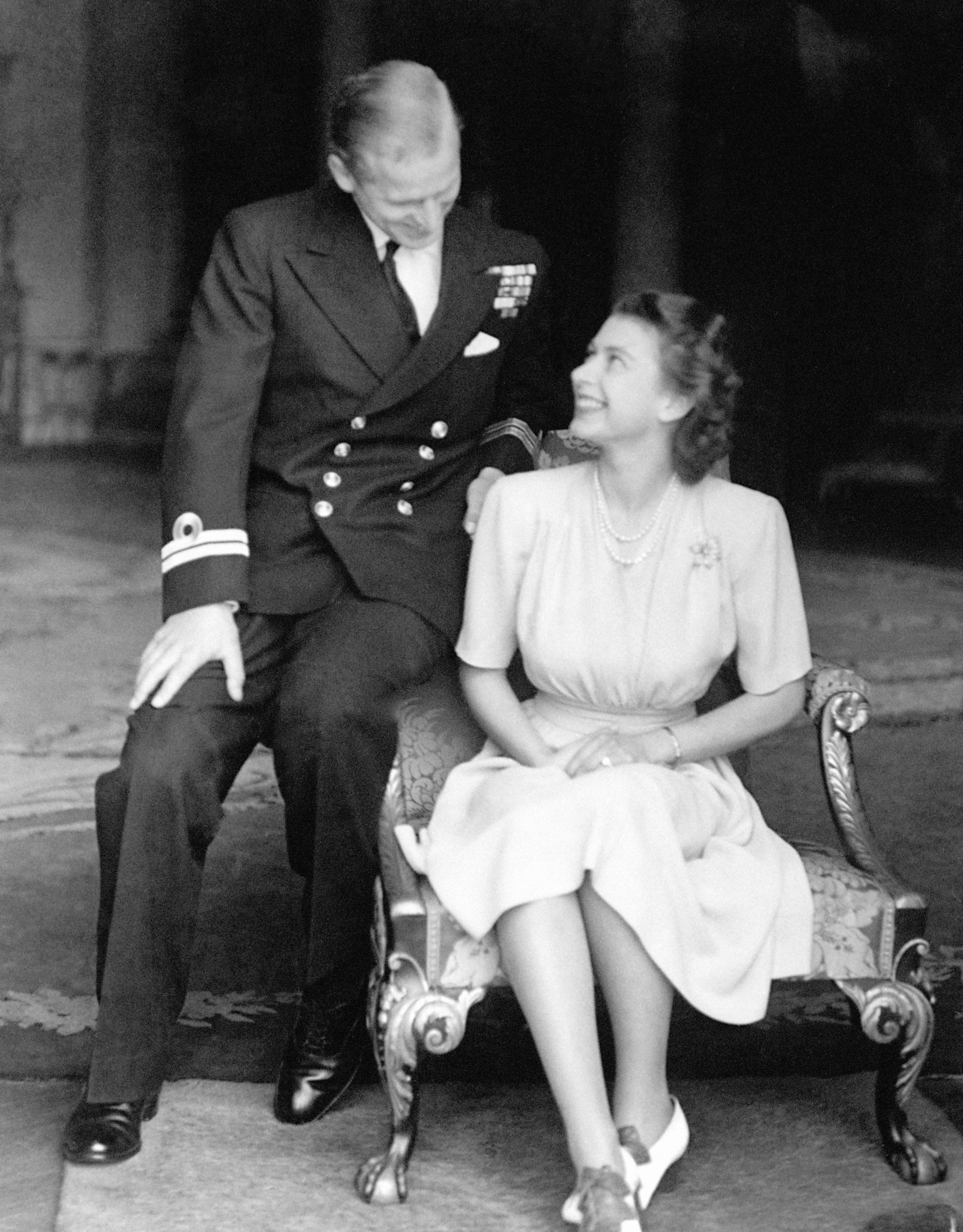 July 1947: Princess Elizabeth, the 21-year-old future queen, at Buckingham Palace with Lieutenant Philip...