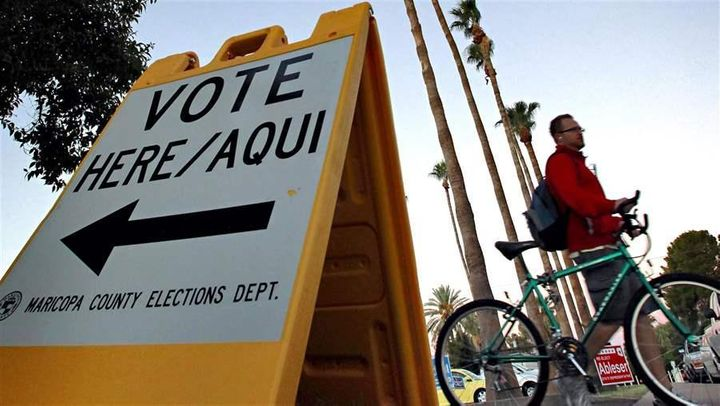 A sign directs voters to a polling station in Tempe, Ariz. Arizona's two-tiered registration system is being challenged in co
