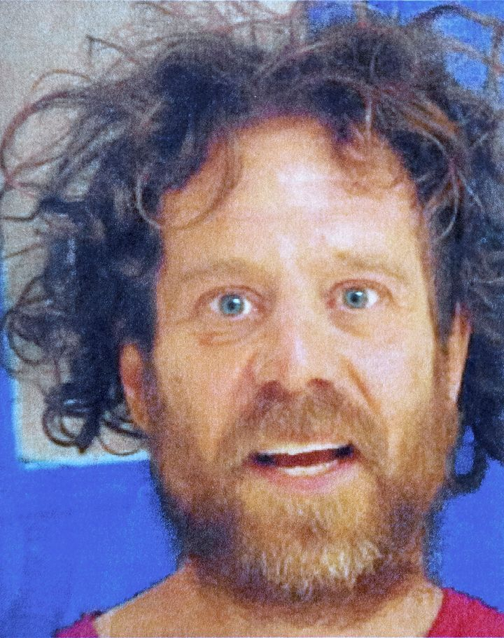 Kevin Neal, seen in a recent booking photo, had a history of domestic violence calls and a protective order against him by tw