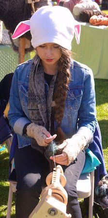 At the Folklife Fair in Hailey, Idaho, a local teen spins wool like her great-grandmother once did.