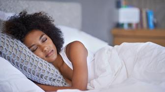 Cropped shot of a young woman asleep on her side