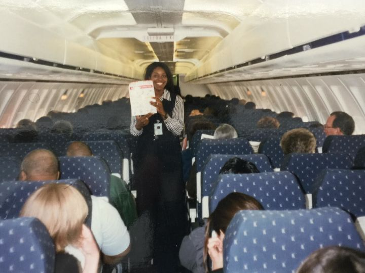 Henderson aboard an AirTrain flight during training for her time as a flight attendant for the airline in 2004.