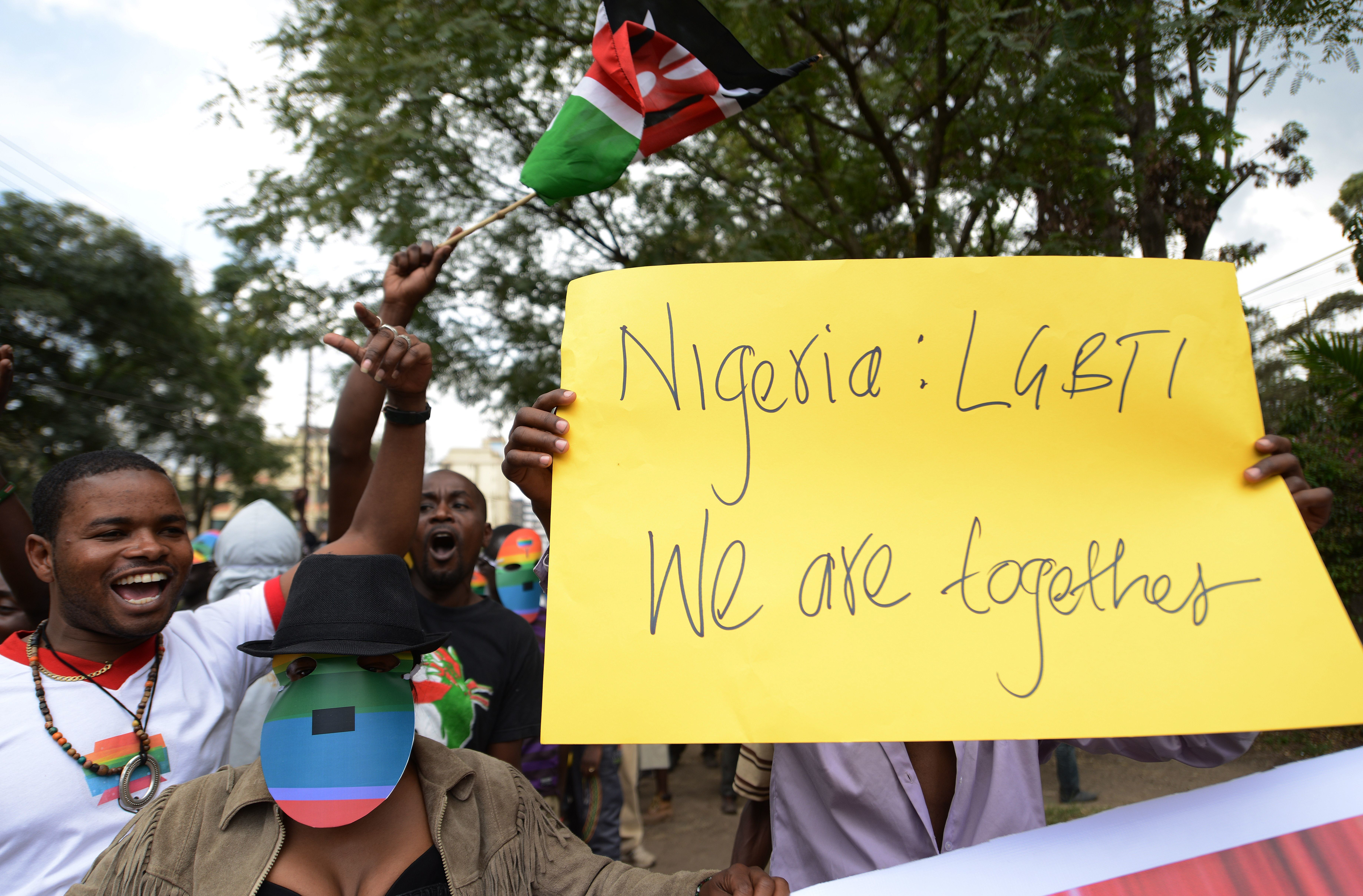 Kenyan gay and lesbian organisations demonstrate outside the Nigerian High Commission in Nairobi on February 7, 2014. Nigerian President Goodluck Jonathan in 2013 had signed a bill into law against gay marriage and civil partnerships. The Same Sex Marriage (Prohibition) Bill 2013 imposes penalties of up to 14 years' imprisonment for anyone found to have entered in to such a union. Anyone who founds or supports gay groups or clubs also runs the risk of a maximum 10-year jail term. The legislation, which effectively reinforces existing laws banning homosexuality in Nigeria, has been widely condemned abroad as draconian and against a raft of human rights conventions. AFP PHOTO/SIMON MAINA        (Photo credit should read SIMON MAINA/AFP/Getty Images)