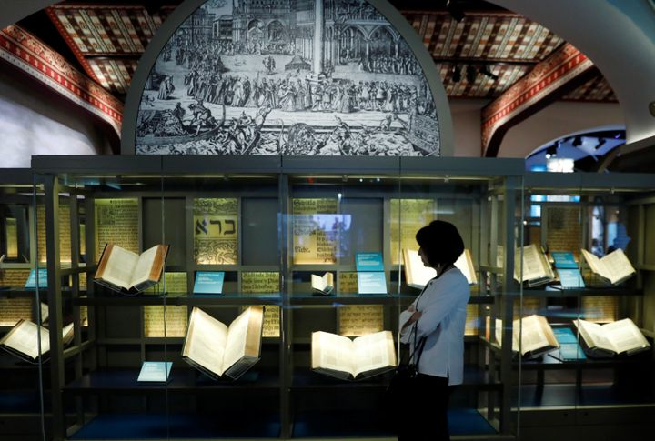 A visitor looks at various Bibles during a preview at the Museum of the Bible on Nov. 14.