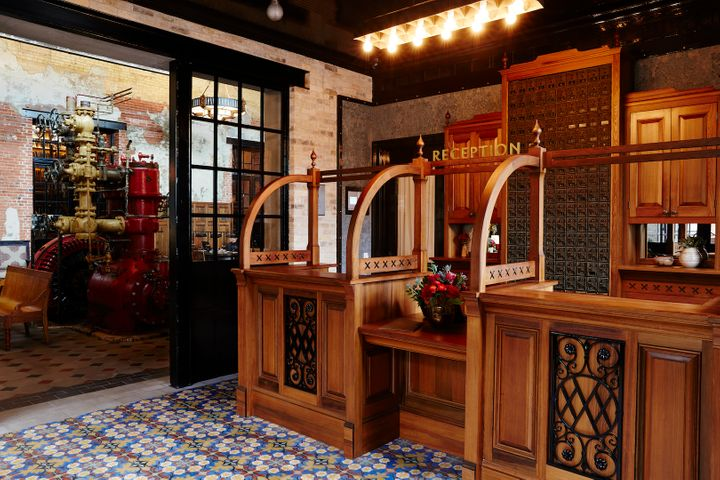 <p>Hotel entrance featuring custom tiles and original machinery from the Pearl brewery era.</p>