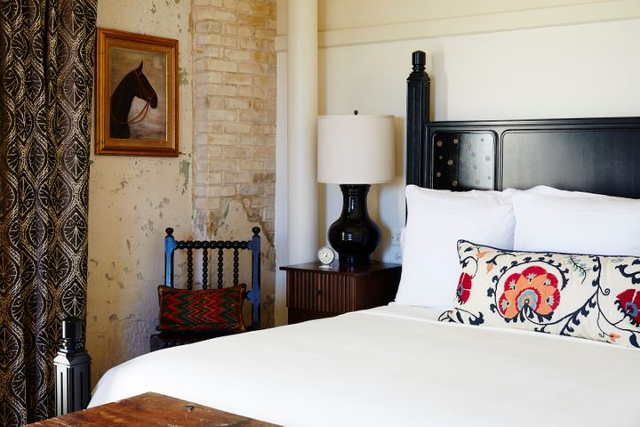 <p>Hotel Emma guest room featuring lacquered bed and custom linens. </p>