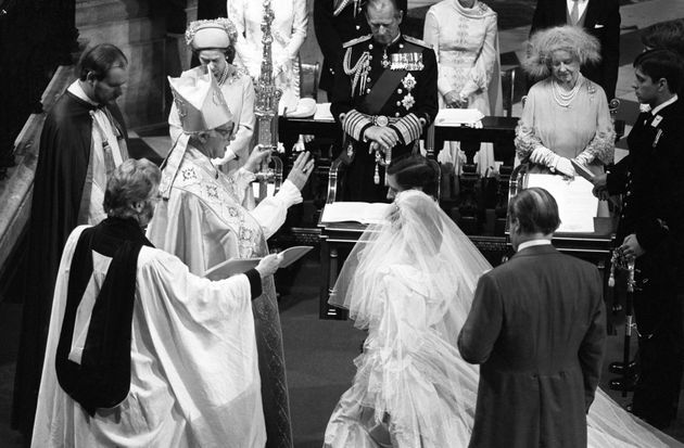 Prince Charles and Princess Diana kneel before the Archbishop of Canterbury Robert Runcie during their...