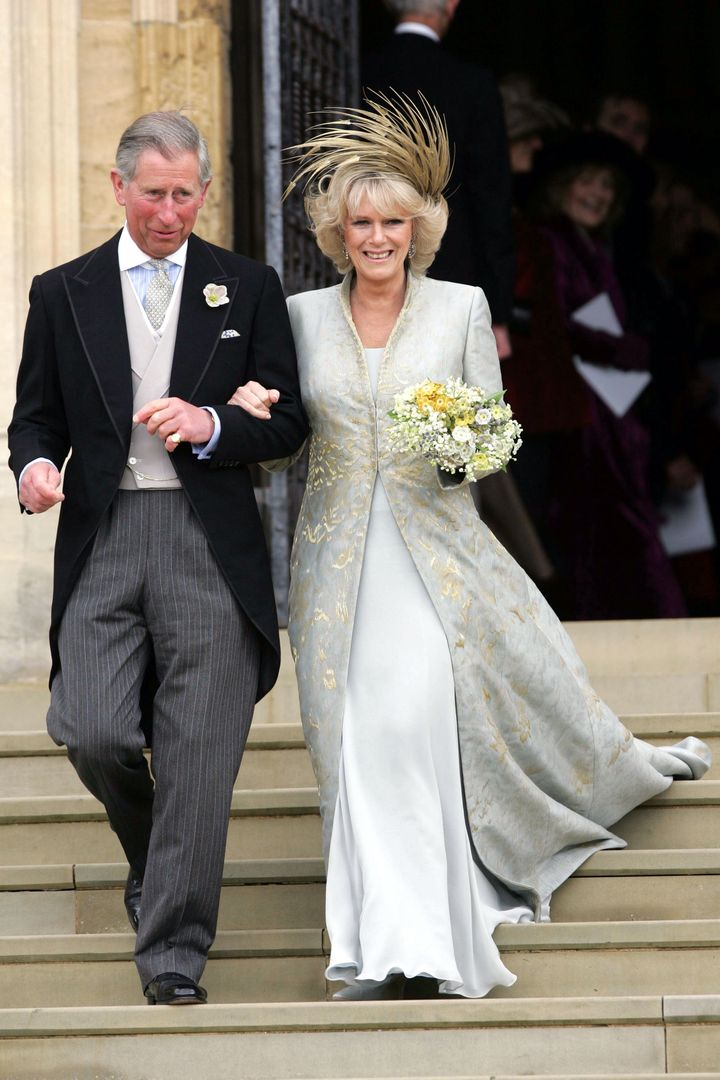 Prince Charles and The Duchess of Cornwall after a service of prayer and dedication following their wedding in April 2005, which starkly contrasted with his grand St Paul's Cathedral wedding to Princess Diana