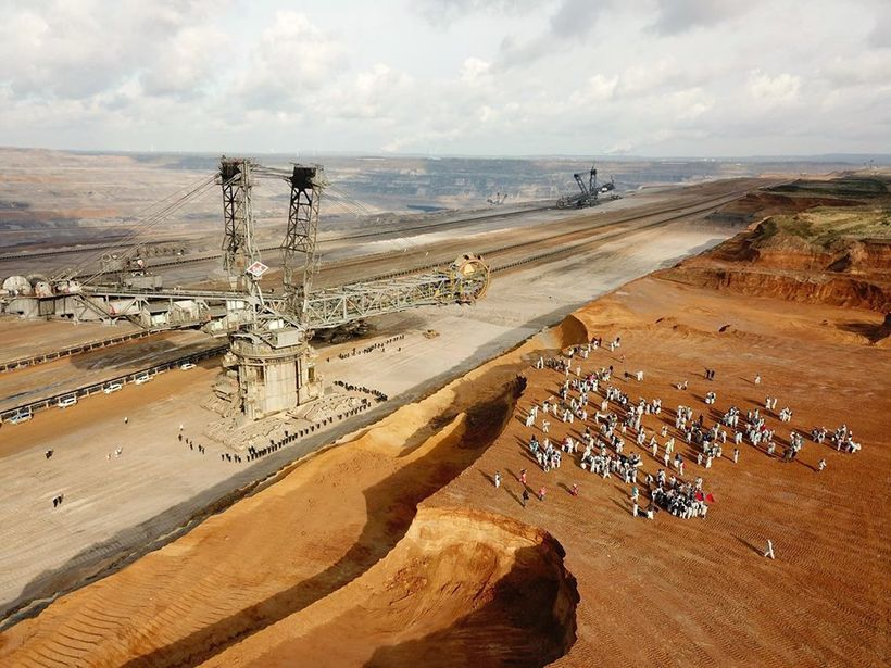 """""""Ende Gelande"""" protestors look over Germany's largest open pit coal mine as police guard the diggers."""
