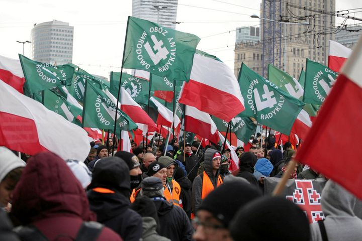 Protesters carry Polish flags and National Radical Camp flags during a rally organized by far-right, nationalist groups to ma