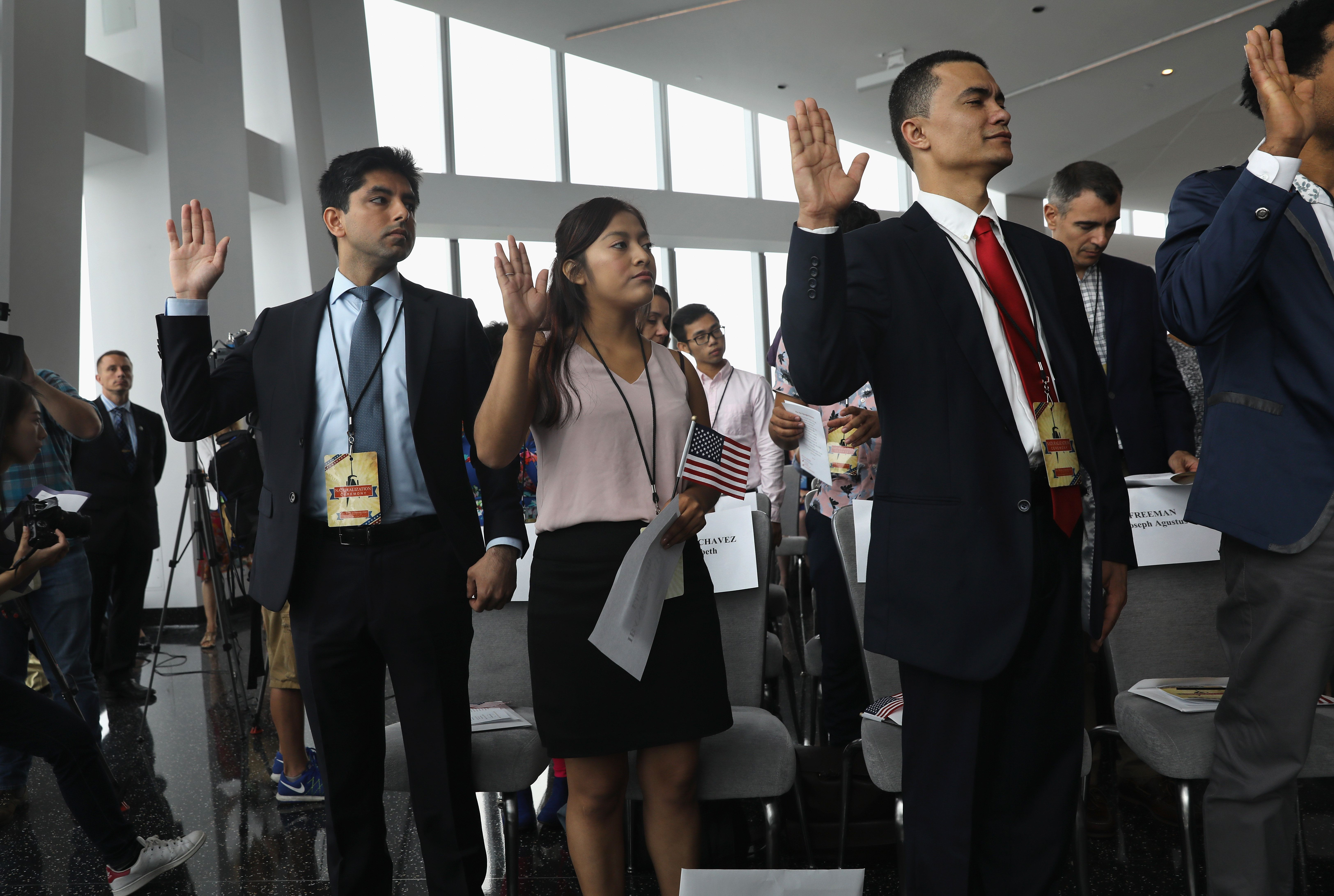 NEW YORK, NY - AUGUST 15:  Immigrants take the oath of allegiance to the United States held in the observatory of the One World Trade Center on August 15, 2017 in New York City. Thirty immigrants took the oath of citizenship to become American citizens at One World Trade, which at 1,776 feet high is the tallest building in the Western Hemishere. (Photo by John Moore/Getty Images)