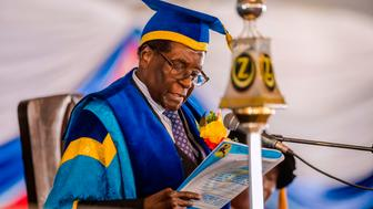 Zimbabwe's President Robert Mugabe delivers a speech during a graduation ceremony at the Zimbabwe Open University in Harare, where he presides as the Chancellor on November 17, 2017.  Zimbabwean President Robert Mugabe attended a university graduation ceremony today, making a defiant first public appearance since the military takeover that appeared to signal the end of his 37-year reign. / AFP PHOTO / STR        (Photo credit should read STR/AFP/Getty Images)