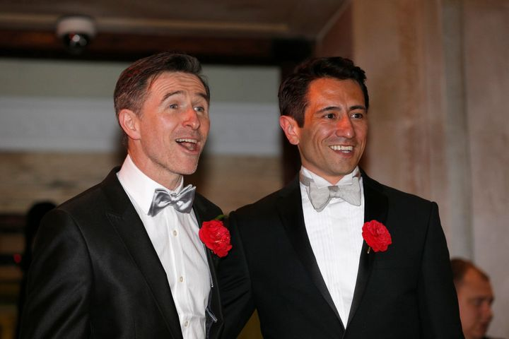 Peter McGraith and David Cabreza after their wedding at Islington Town Hall, one of the first same sex couples to wed in England and Wales