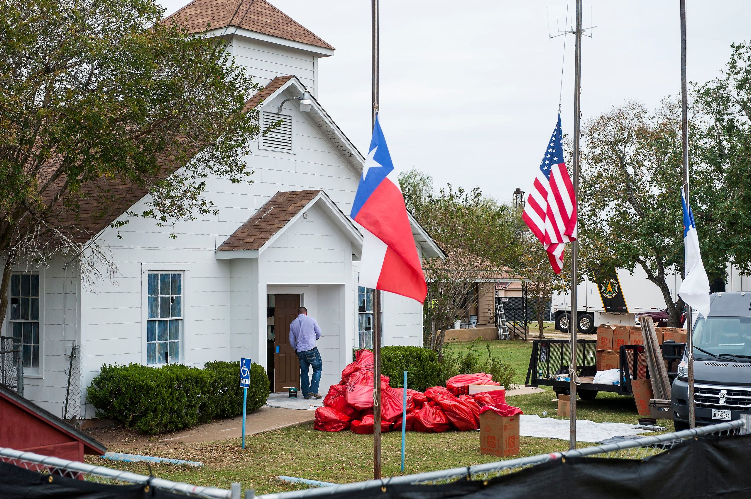 Plastic bags are piled up outside First Baptist Church in Sutherland Springs, Texas, as hazardous materials are removed from
