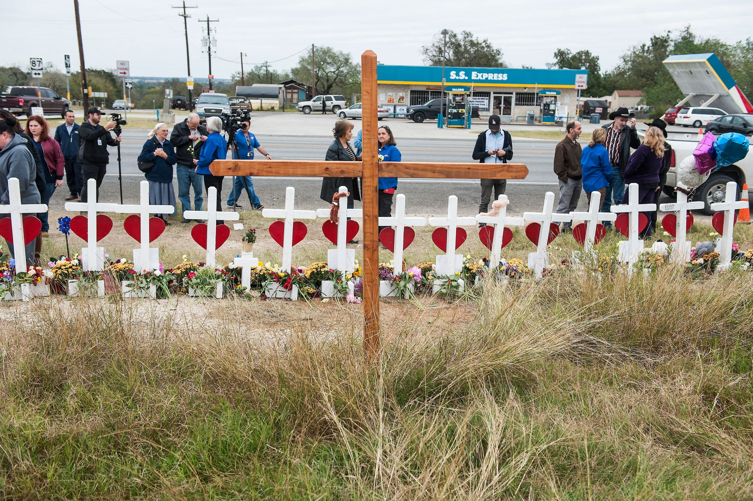 The crosses, erected across the street from the church, have become a meeting ground for mourners.