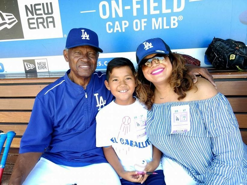 Famed LA Dodger, Manny Mota, alongside Sonia Smith-Kang and son