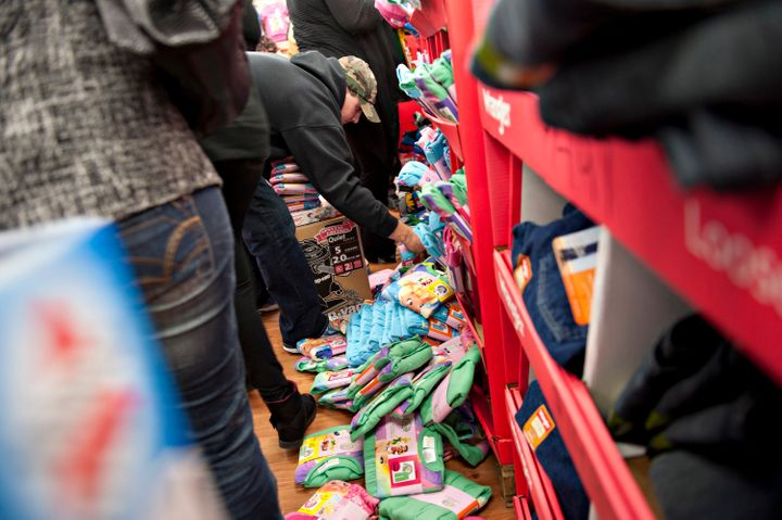 People rifle through a bin of Black Friday-priced children's pajamas at a Walmart store in Ohio in 2011.