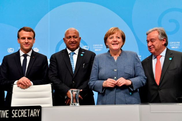 From left to right:French President Emmanuel Macron; prime minister of Fiji and president of COP...
