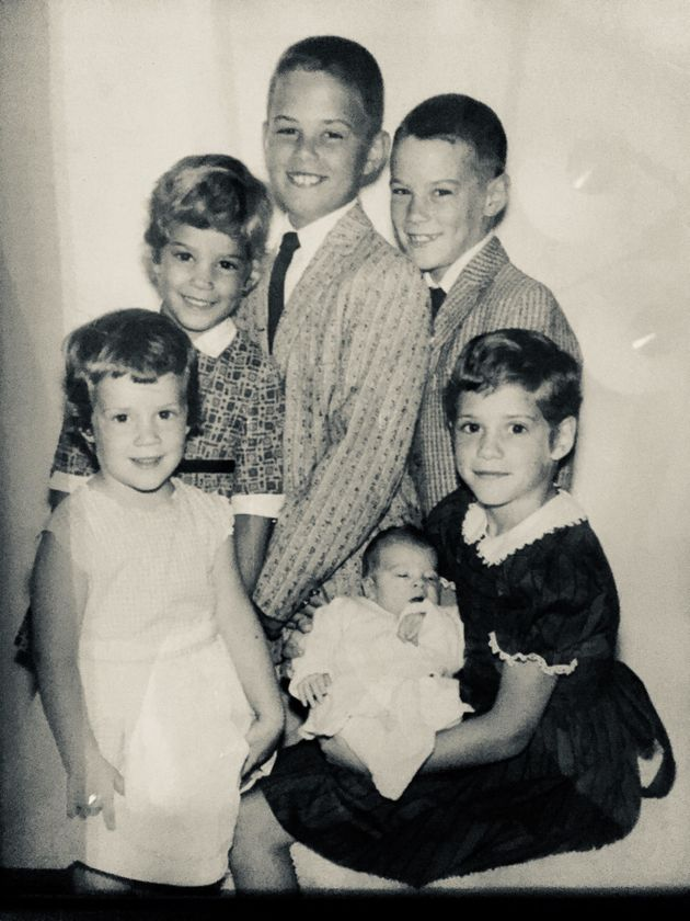 Clockwise from lower left:Marianne, Kathy, Michael, Tommy and Terry,who's holding Patrick. (The youngest...