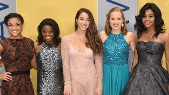 NASHVILLE, TN - NOVEMBER 02:  (L-R) Olympic gymnasts Laurie Hernandez, Simone Biles, Aly Raisman, Madison Kocian, and Gabby Douglas attend the 50th annual CMA Awards at the Bridgestone Arena on November 2, 2016 in Nashville, Tennessee.  (Photo by John Shearer/WireImage)