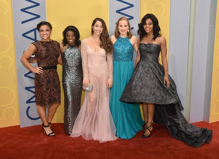 Gabby douglas says dressing provocatively entices wrong crowd olympic gymnasts laurie hernandez left simone biles aly raisman madison kocian and m4hsunfo