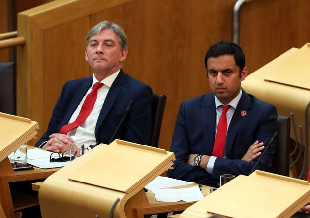 Richard Leonard, left, in the Scottish Parliament chamber alongside Anas