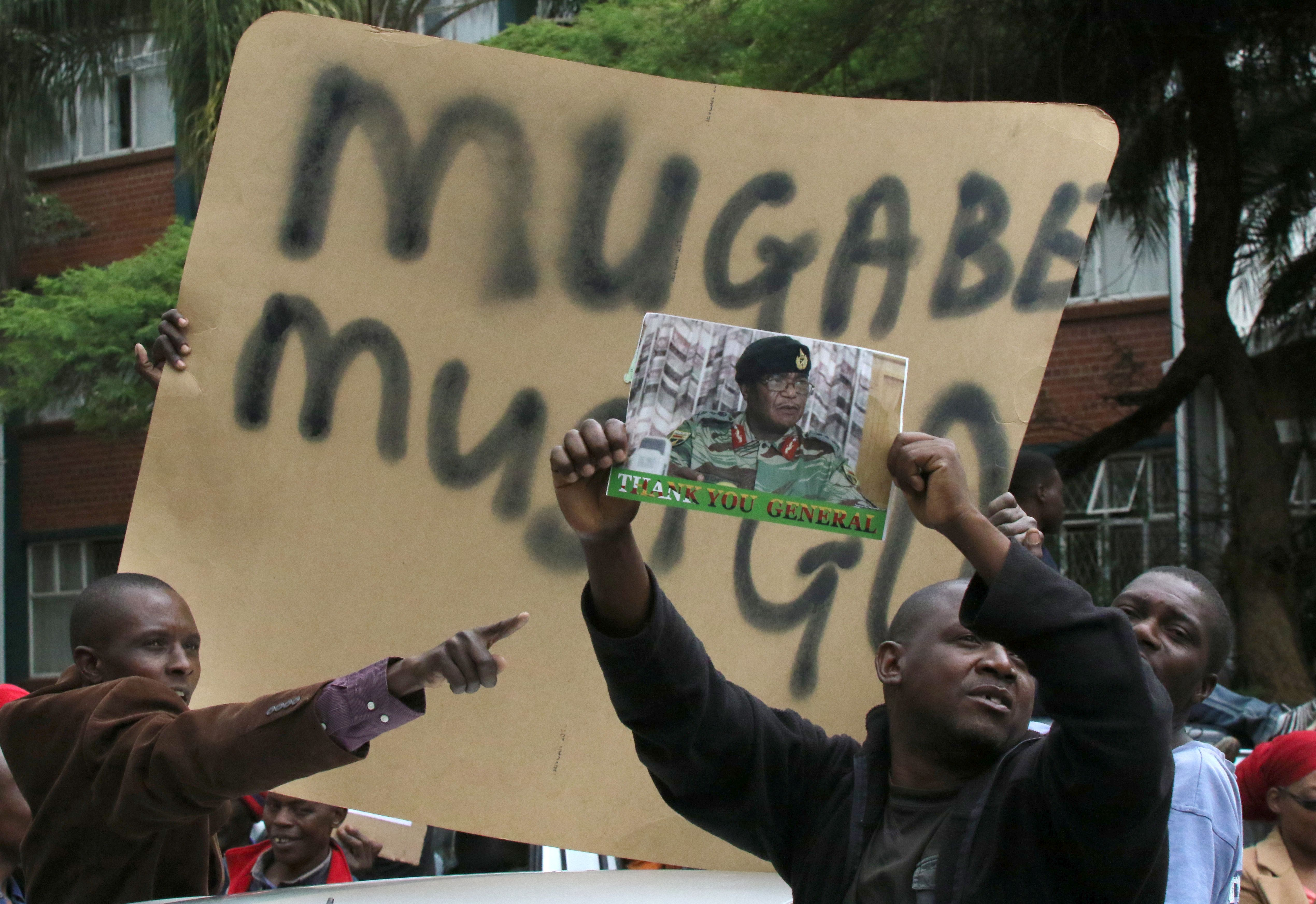Protesters calling for Zimbabwean President Robert Mugabe to step down take to the streets in Harare, Zimbabwe, November 18, 2017. REUTERS/Philimon Bulawayo