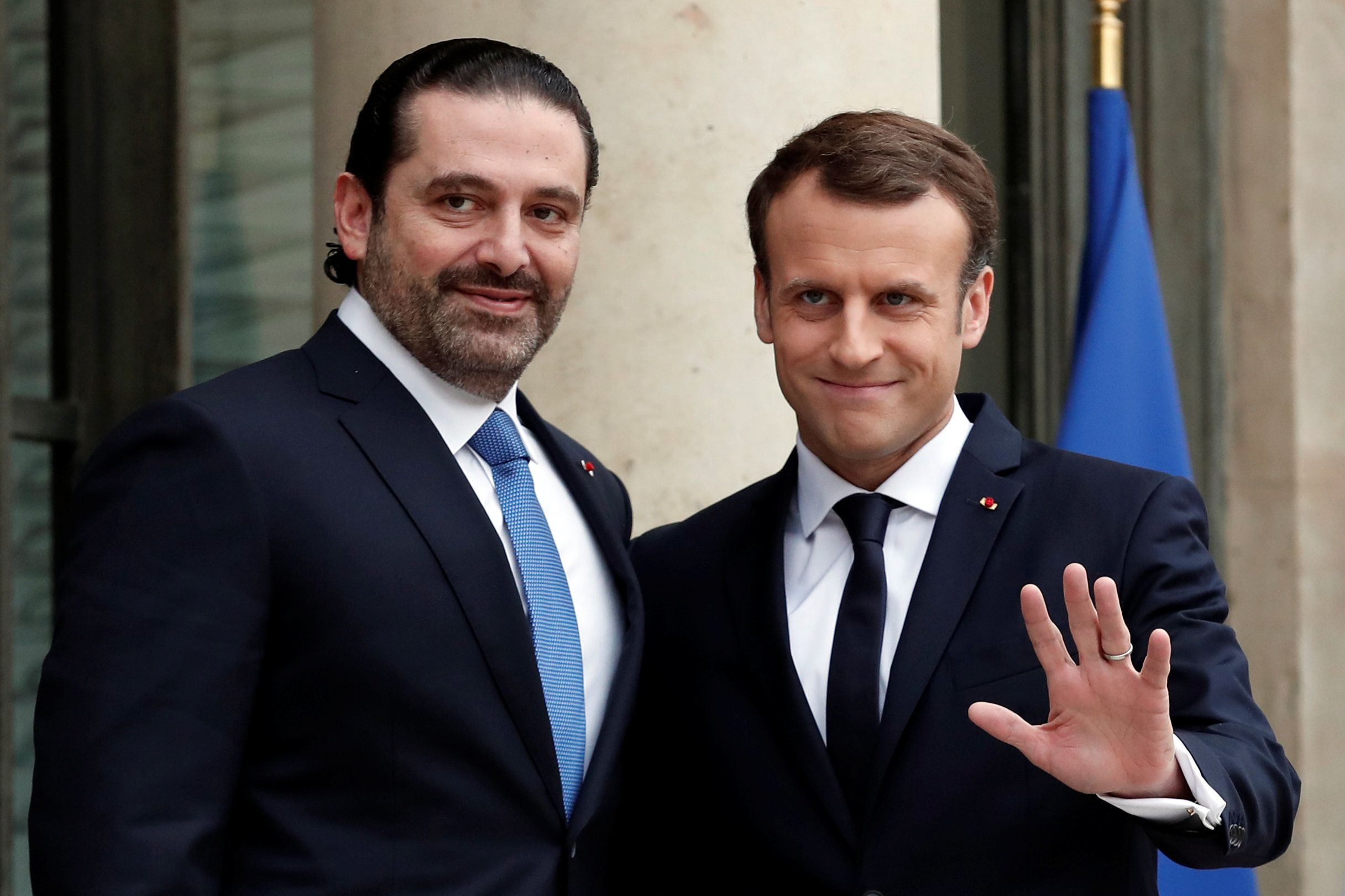 French President Emmanuel Macron and Saad al-Hariri, who announced his resignation as Lebanon's prime minister while on a visit to Saudi Arabia, react on the steps of the Elysee Palace in Paris, France, November 18, 2017. REUTERS/Benoit Tessier