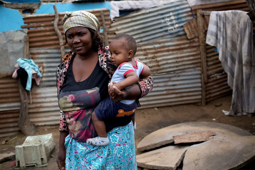 <em>Yvonne Antonoia Mathe looks after her sister's eight-month-old boy Wagner at her home in Maputo, Mozambique, Thursda