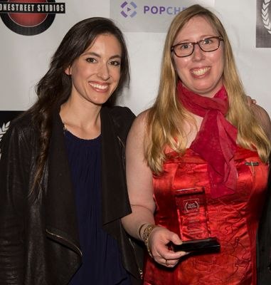 Actress Katherine Cello (L) and Best Director winner Holly Chadwick (R) pose for the cameras at NYC Web Fest.