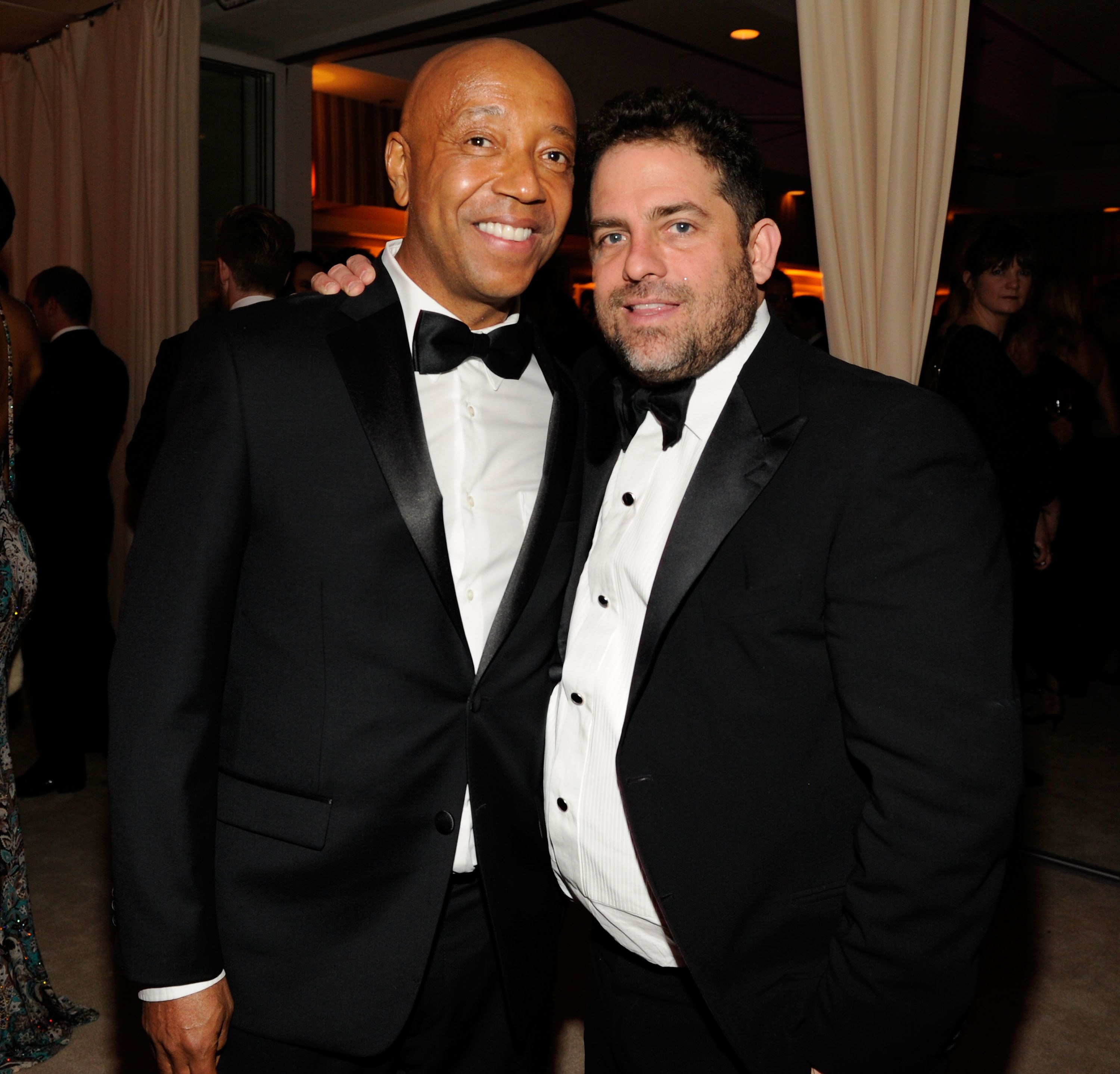 WEST HOLLYWOOD, CA - FEBRUARY 24:  (EXCLUSIVE ACCESS SPECIAL RATES APPLY; NO NORTH AMERICAN ON-AIR BROADCAST UNTIL FEBRUARY 28, 2013) Russell Simmons and Brett Ratner attends the 2013 Vanity Fair Oscar Party hosted by Graydon Carter at Sunset Tower on February 24, 2013 in West Hollywood, California.  (Photo by Kevin Mazur/VF13/WireImage)