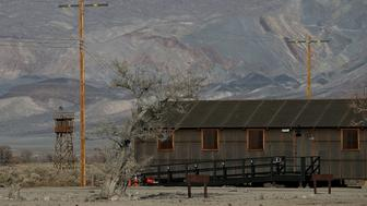 INDEPENDENCE, CA - DECEMBER 09:  A replica of internment camp barracks sits near a watch tower at Manzanar National Historic Site on December 9, 2015 near Independence, California. Recent presidential campaign rhetoric against Muslims in the wake of terror attacks has drawn comparisons to World War II era incarceration of Japanese Americans. Manzanar War Relocation Center was one of ten internment camps where Japanese American citizens and resident Japanese aliens were incarcerated from 1942 to 1945 during World War II.  (Photo by Justin Sullivan/Getty Images)