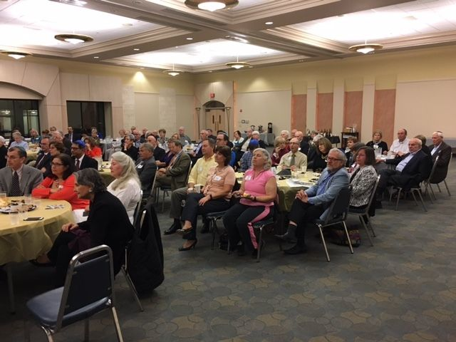 A full-house audience at Temple Beth Ami watches on as Ambassador Akbar Ahmed delivers his Shabbat dinner lecture on Jewish-M