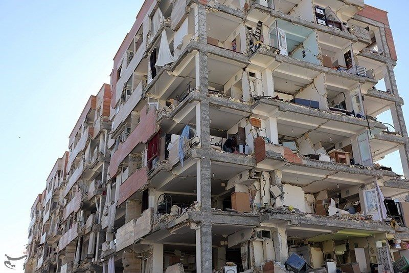 "Damaged apartment block of <a rel=""nofollow"" href=""https://en.wikipedia.org/wiki/Construction_industry_of_Iran#Mehr_Housing_S"