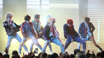 LOS ANGELES, CA - NOVEMBER 19:  BTS performs 'DNA' onstage during the 2017 American Music Awards held at Microsoft Theater on November 19, 2017 in Los Angeles, California.  (Photo by Michael Tran/FilmMagic)