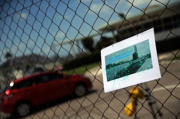 A card for the crew of the missing submarine hangs on a fence at the Argentine Naval Base it sailed