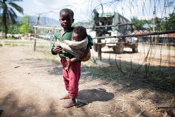 A child in Bunyampuli, in the North Kivu province of the Democratic Republic of the Congo, seeks refuge near a UN camp after