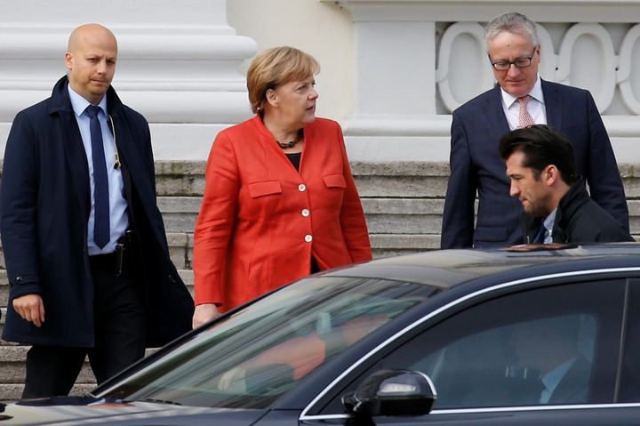 German Chancellor Angela Merkel leaves a meeting with President Frank-Walter Steinmeier after coalition government talks