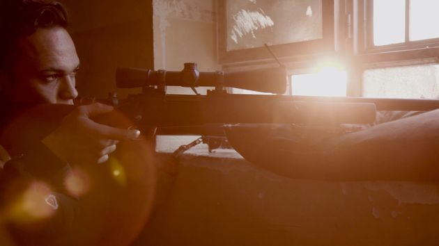 A sniper on lookout in a school in West